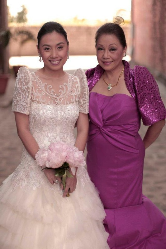 The mother of the bride in a modern sequined terno bolero